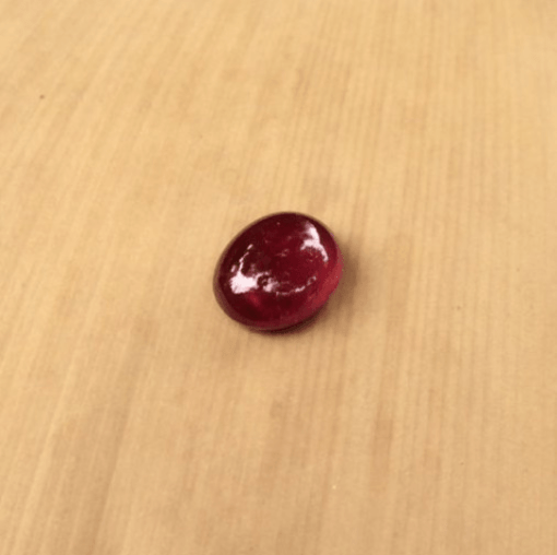 dark red cabochon ruby 8x6mm oval 1.5 carats LSG616